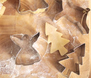 Christmas cookie cutters and dough. Close up of Christmas cookie cutters and dough Royalty Free Stock Images