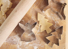 Christmas cookie cutters and dough Stock Photos