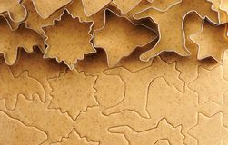 Christmas cookie cutters over gingerbread dough Stock Image