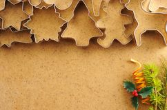 Christmas cookie cutters over gingerbread dough Stock Images