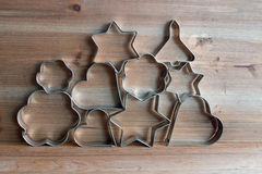 Christmas cookie cutters. On wooden background Royalty Free Stock Images
