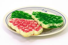 Christmas Cookie Plate. Saucer of 3 Christmas cookies shaped like trees Royalty Free Stock Image