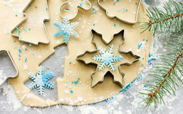 Christmas cookie preparation - raw dough, christmas tree branch Royalty Free Stock Images