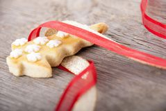 Christmas cookie in ribbon Royalty Free Stock Photo
