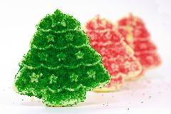 Christmas Cookie Row 1. Row of Christmas Cookies with a pair of red trees behind Stock Image