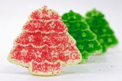 Christmas Cookie Row 2. Row of Christmas cookies shaped like trees with a red tree in front Royalty Free Stock Images