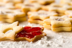 Christmas cookie stars with strawberry jam Stock Photos