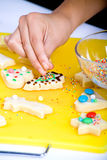 Christmas cookies. Kids baking and decorating christmas cookies Stock Photo