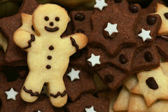 Christmas cookies. Star shaped christmas cookies and a cookie guy Royalty Free Stock Photography