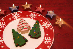 Christmas cookies. In plate with candle Royalty Free Stock Images