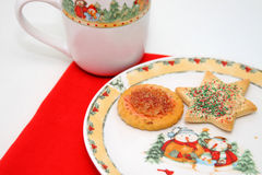 Christmas Cookies. On a snowman plate with a red placemat and holiday mug Royalty Free Stock Images
