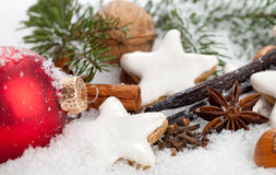 Christmas Cookies. With some christmas decoration (anise, cinnamon, vanilla, nuts) in a winter wonderland (snow stock photos