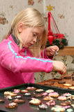 Christmas cookies. Children making christmas cookies in the kitchen Royalty Free Stock Images