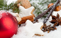 Christmas Cookies. Some spices and some christmas decoration in snow stock photography