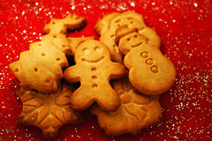 Christmas cookies. On red table stock photo