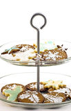 Christmas cookies. Gingerbread and shortbread cookies stenciled and iced in Christmas designs on glass cake stand Stock Photo