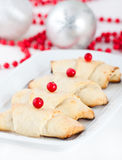 Christmas cookies. And decorations on a plate Royalty Free Stock Photo