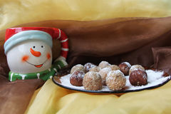 Christmas cookies. And snowman cup of milk,  on two colors cloth Stock Image