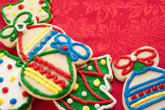 Christmas Cookies. In the shapes of trees and ornaments. Homemade. Red cloth copy space. Shot in natural light Royalty Free Stock Photos