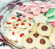 Christmas Cookies. Glass plate of Christmas cookies royalty free stock image