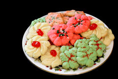 Christmas Cookies. A full plate of festive and colorful Christmas cookies.  Isolated on black with copy space Stock Photography