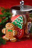 Christmas cookies. Gingerbread man next to a cookie jar filled with Christmas cookies royalty free stock photos