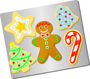 Christmas Cookies/ai. Illustration of Christmas cut-out gingerbread and sugar cookies on a baking sheet royalty free illustration