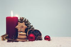 Free Christmas Cookies And Red Advent Candle On Gray. Stock Images - 125826524