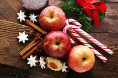 Christmas cookies, apples, gingerbread and spice on brown backgr. Ound Stock Images