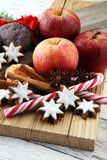 Christmas cookies, apples, gingerbread and spice on white backgr. Ound Stock Images