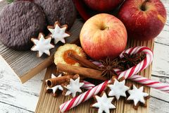 Christmas cookies, apples, gingerbread and spice on white backgr. Ound Royalty Free Stock Photography