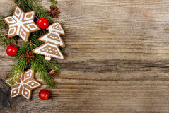 Christmas cookies and apples on wooden background