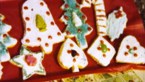 Christmas Cookies (Archival 1950s). Shot on Super 8mm film. Telecine HD frame by frame digital 4:2:2 transfer. We keep all our original films stored in an stock video