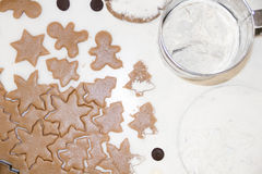 Christmas cookies. Baking . Roll out the dough to cut stars on a wooden background Stock Images