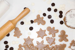 Christmas cookies. Baking . Roll out the dough to cut stars on a wooden background Stock Photos
