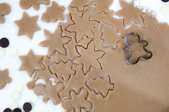 Christmas cookies. Baking . Roll out the dough to cut stars on a wooden background Royalty Free Stock Images