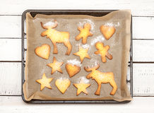 Christmas cookies on a baking tray with free text space Royalty Free Stock Photography