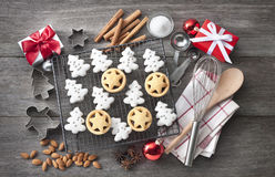 Christmas Holiday Cookies Baking. Christmas cookies with baking utensils, ingredients and Xmas presents on a rustic wood background from overhead stock images