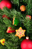 Christmas cookies and balloons on the tree. A fragment of a Christmas tree. Christmas tree decorated with Christmas cookies and balloons. Cookies are hand Royalty Free Stock Images