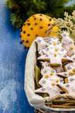 Christmas cookies in a basket. On the background of Christmas tree branches Stock Image