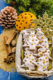 Christmas cookies in a basket. On the background of Christmas tree branches Stock Photos