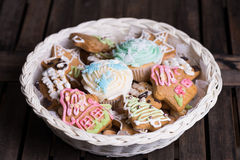 Christmas cookies in a basket. Christmas cookies, decorated with sugar in a basket royalty free stock image