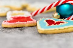 Christmas cookies, bauble and candy cane on grey background royalty free stock images