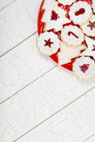 Christmas Cookies. Beautiful assorted Christmas cookies arranged on a red plate over a white wooden background. Copy Space royalty free stock image