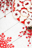 Christmas Cookies. Beautiful assorted Christmas cookies arranged on a red plate over a white wooden background with decorations royalty free stock photos