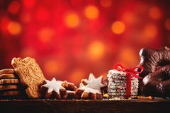 Christmas cookies and biscuits festive background. Arranged on a rustic wooden table with spicy speculoos, starsand chocolate confections, low angle with Stock Photo