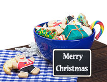 Christmas cookies and a blackboard. With congratulations Royalty Free Stock Photo