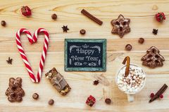 Christmas cookies and blackboard with festive decoration on wood royalty free stock photo