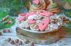 Christmas cookies in bowl. Valentine`s day or Christmas cookies in bowl. Gingerbread heart cookies on a wooden background stock photo