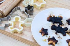 Christmas cookies burn on wood table Royalty Free Stock Photography